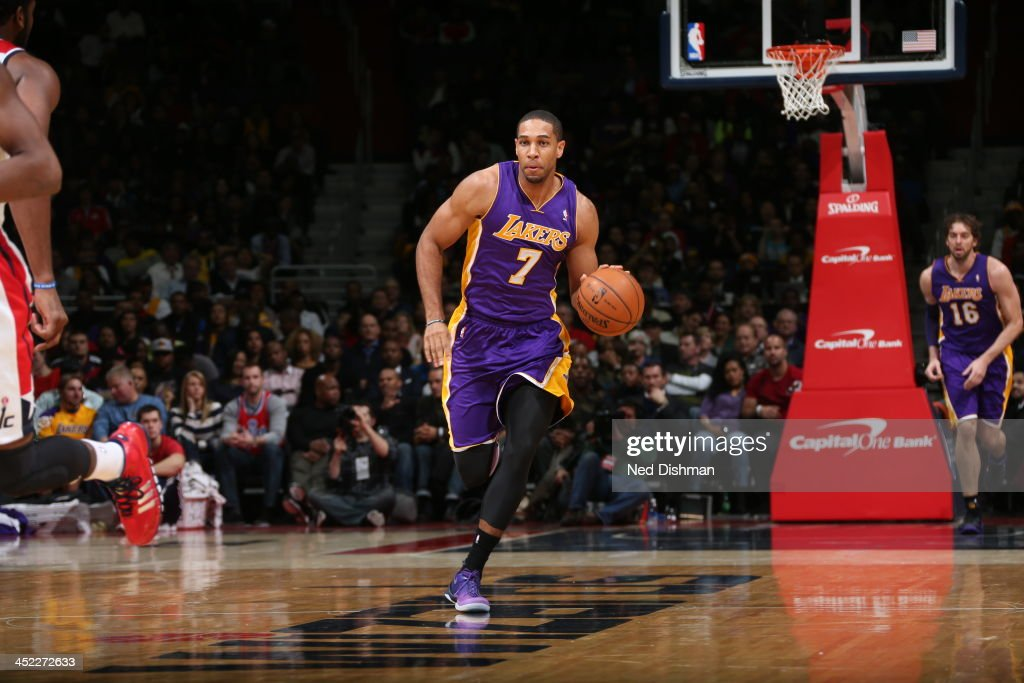 <a gi-track='captionPersonalityLinkClicked' href=/galleries/search?phrase=Xavier+Henry&family=editorial&specificpeople=5792007 ng-click='$event.stopPropagation()'>Xavier Henry</a> #7 of the Los Angeles Lakers dribbles up the floor against the Washington Wizards during the game at the Verizon Center on November 26, 2013 in Washington, DC.