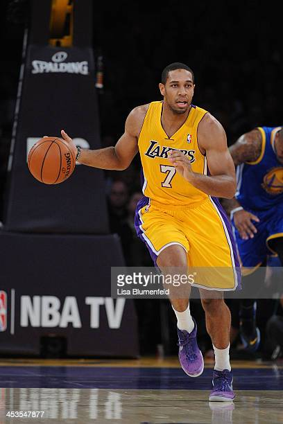 Xavier Henry of the Los Angeles Lakers drives the ball uocourt during the game against the Golden State Warriors at Staples Center on November 22...