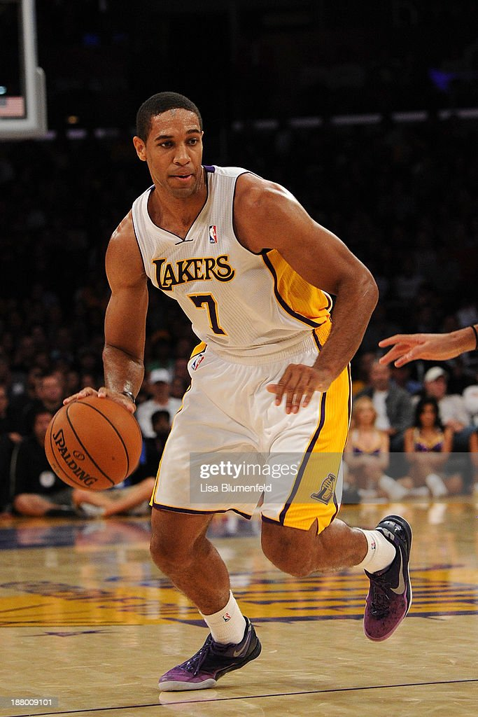Xavier Henry of the Los Angeles Lakers drives the ball upcourt during the game against the Minnesota Timberwolves at Staples Center on November 10...