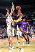 Xavier Henry of the Los Angeles Lakers drives to the basket against the New Orleans Pelicans on November 8 2013 at the New Orleans Arena in New...