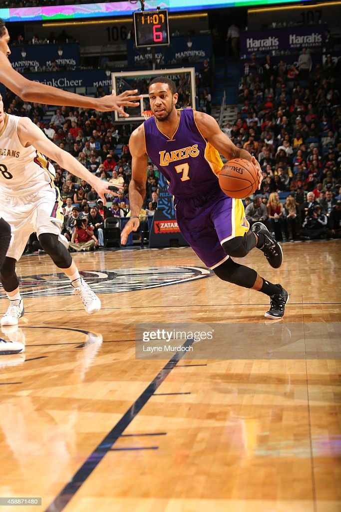 Xavier Henry of the Los Angeles Lakers drives to the basket against the New Orleans Pelicans on November 12 2014 at the Smoothie King Center in New...