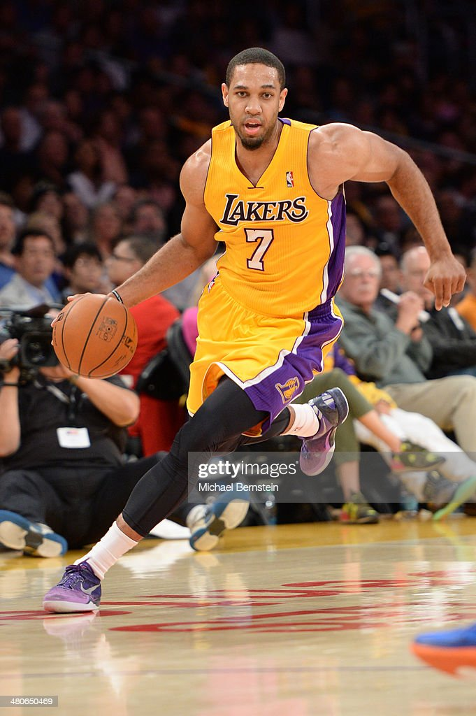 Xavier Henry of the Los Angeles Lakers drives to the basket during a game against the New York Knicks at STAPLES Center on March 25 2014 in Los...