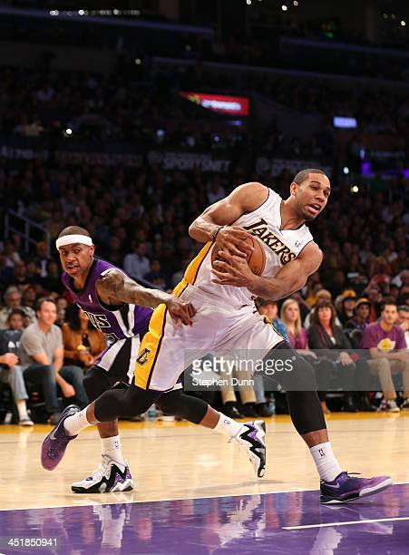 Xavier Henry of the Los Angeles Lakers drives to the basket past Isaiah Thomas of the Sacramento Kings at Staples Center on November 24 2013 in Los...