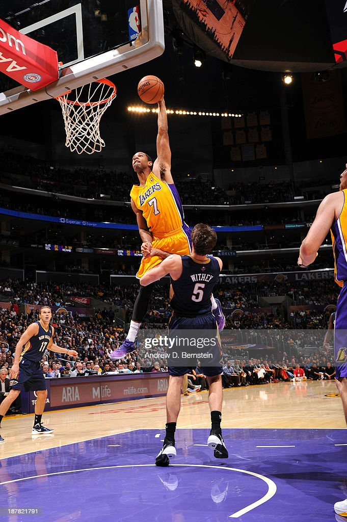 Xavier Henry #7 of the Los Angeles Lakers dunks against Jeff Withey #5 of the New Orleans Pelicans at Staples Center on November 12, 2013 in Los Angeles, California.