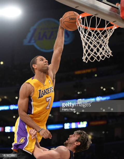Xavier Henry of the Los Angeles Lakers dunks over Jeff Withey of the New Orleans Pelicans during a 11695 Laker win at Staples Center on November 12...