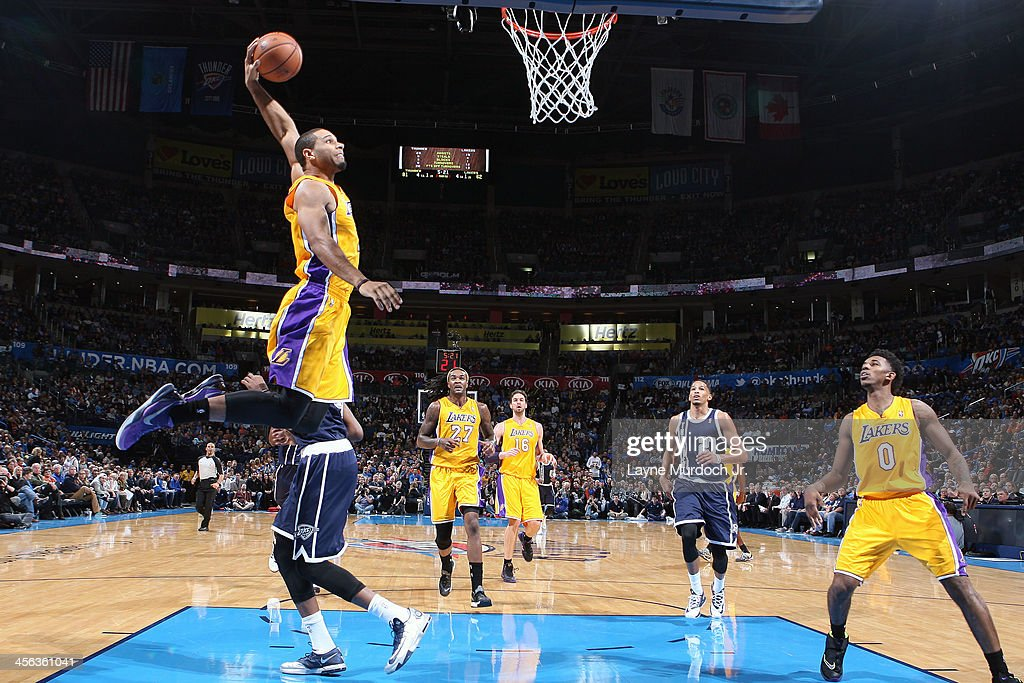 Xavier Henry of the Los Angeles Lakers dunks the ball against the Oklahoma City Thunder on December 13 2013 at the Chesapeake Energy Arena in...