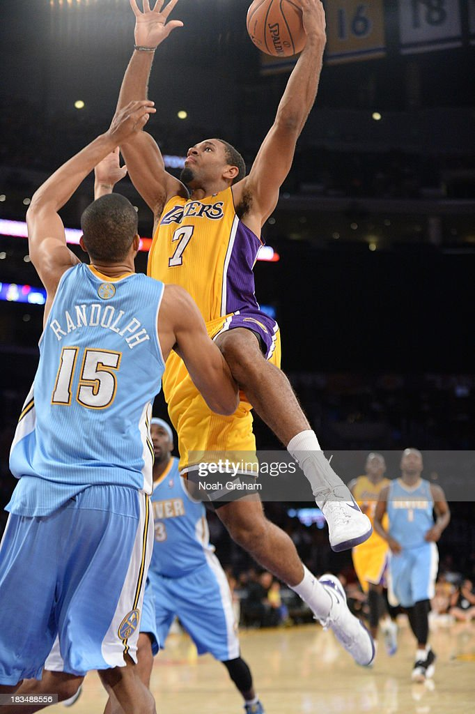 <a gi-track='captionPersonalityLinkClicked' href=/galleries/search?phrase=Xavier+Henry&family=editorial&specificpeople=5792007 ng-click='$event.stopPropagation()'>Xavier Henry</a> #7 of the Los Angeles Lakers goes to the basket against <a gi-track='captionPersonalityLinkClicked' href=/galleries/search?phrase=Anthony+Randolph+-+Basketball+Player&family=editorial&specificpeople=4679330 ng-click='$event.stopPropagation()'>Anthony Randolph</a> #15 of the Denver Nuggets at STAPLES Center on October 10, 2013 at in Los Angeles, California.