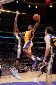 Xavier Henry of the Los Angeles Lakers goes to the basket against the Utah Jazz at Staples Center on October 22 2013 in Los Angeles California NOTE...