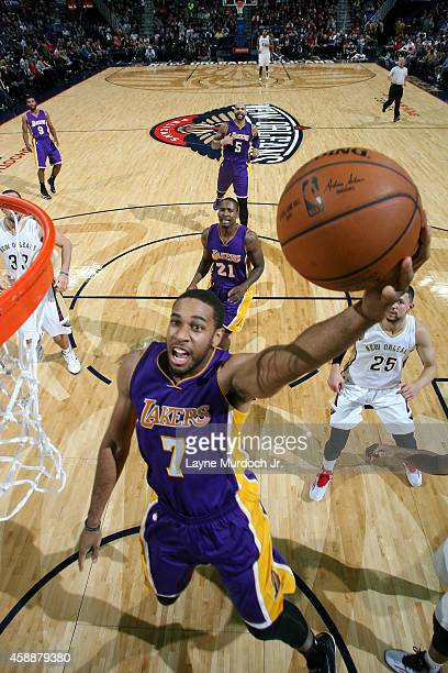 Xavier Henry of the Los Angeles Lakers goes to the basket against the New Orleans Pelicans on November 12 2014 at the Smoothie King Center in New...