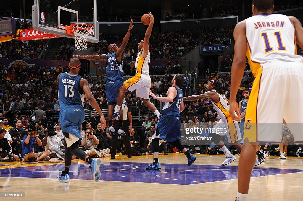 Xavier Henry #7 of the Los Angeles Lakers goes up for a dunk against Dante Cunningham #33 of the Minnesota Timberwolves at Staples Center on November 10, 2013 in Los Angeles, California.