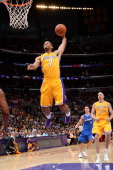 Xavier Henry of the Los Angeles Lakers goes up for a dunk against the Los Angeles Clippers at Staples Center on October 29 2013 in Los Angeles...