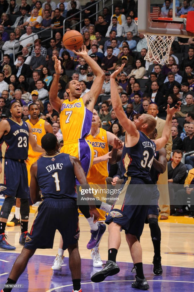Xavier Henry of the Los Angeles Lakers goes up for a shot against Greg Stiemsma of the New Orleans Pelicans at Staples Center on November 12 2013 in...