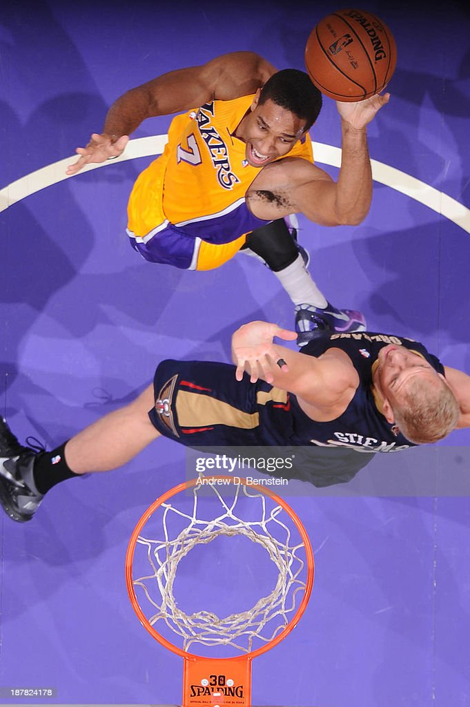 Xavier Henry #7 of the Los Angeles Lakers goes up for a shot against Greg Stiemsma #34 of the New Orleans Pelicans at Staples Center on November 12, 2013 in Los Angeles, California.