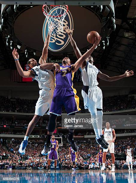 Xavier Henry of the Los Angeles Lakers goes up for a shot against the Dallas Mavericks during the game on November 21 2014 at the American Airlines...