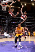 Xavier Henry of the Los Angeles Lakers goes up for a shot against the Portland Trail Blazers at Staples Center on April 1 2014 in Los Angeles...