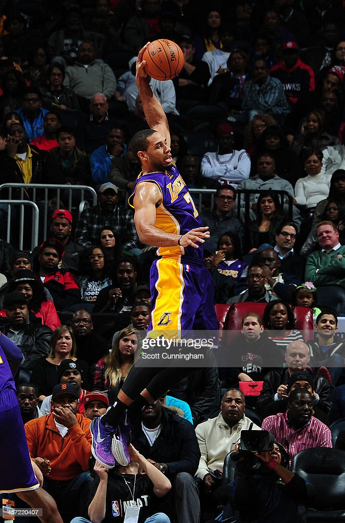 Xavier Henry of the Los Angeles Lakers grabs a rebound against the ball in midair against the Atlanta Hawks on December 16 2013 at Philips Arena in...