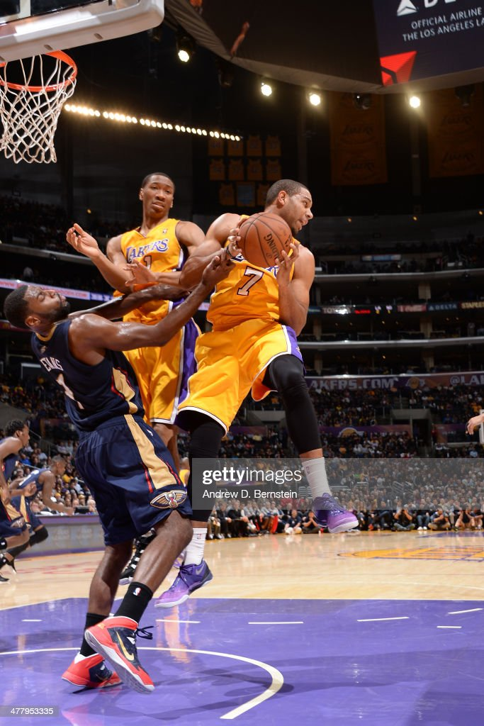 Xavier Henry #7 of the Los Angeles Lakers grabs a rebound against the New Orleans Pelicans at Staples Center on March 4, 2014 in Los Angeles, California.