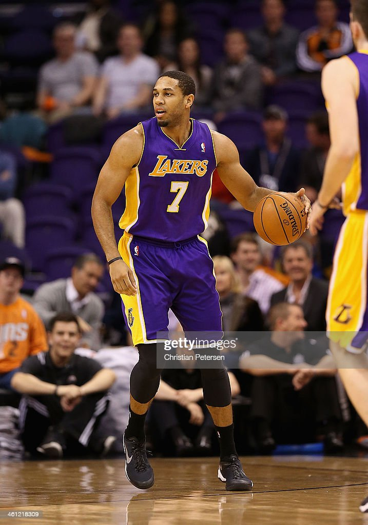 Xavier Henry of the Los Angeles Lakers handles the ball during the NBA game against the Phoenix Suns at US Airways Center on December 23 2013 in...