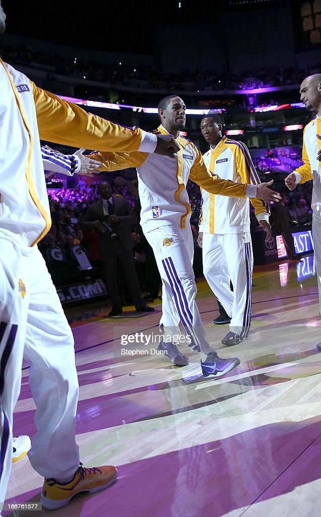 Xavier Henry #7 of the Los Angeles Lakers is greeted by teammates as he introduced in the starting lineup for the game against the Atlanta Hawks at Staples Center on November 3, 2013 in Los Angeles, California. The Lakers won 105-103.