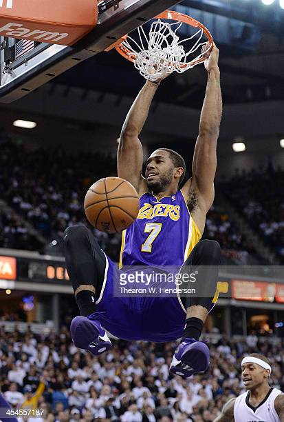 Xavier Henry of the Los Angeles Lakers jams the ball against the Sacramento Kings at Sleep Train Arena on December 6 2013 in Sacramento California...