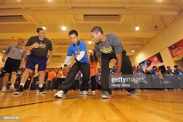 Xavier Henry of the Los Angeles Lakers runs drills with the participants during the NBA Cares Special Olympics Clinic as part of the 2013 Global...