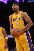 Xavier Henry of the Los Angeles Lakers shoots a free throw during a game against the San Antonio Spurs on November 1 2013 at STAPLES Center in Los...