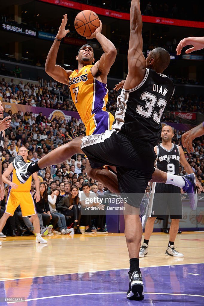 Xavier Henry #7 of the Los Angeles Lakers shoots against Boris Diaw #33 of the San Antonio Spurs on November 1, 2013 at STAPLES Center in Los Angeles, California.