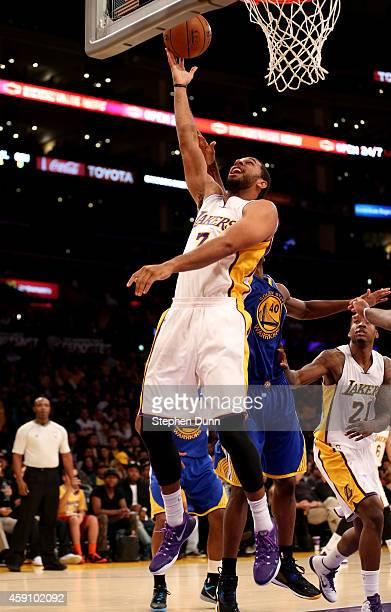 Xavier Henry of the Los Angeles Lakers shoots against the Golden State Warriors at Staples Center on November 16 2014 in Los Angeles California The...
