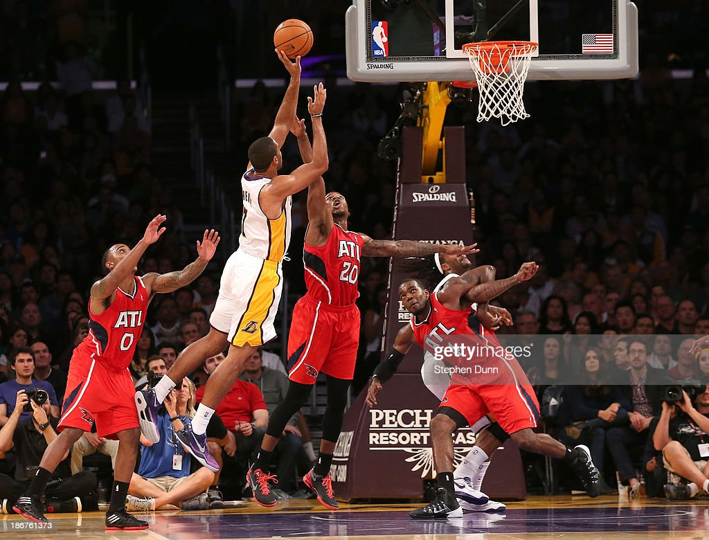 Xavier Henry #7 of the Los Angeles Lakers shoots over Cartier martin #20 of the Atlanta Hawks at Staples Center on November 3, 2013 in Los Angeles, California. The Lakers won 105-103.
