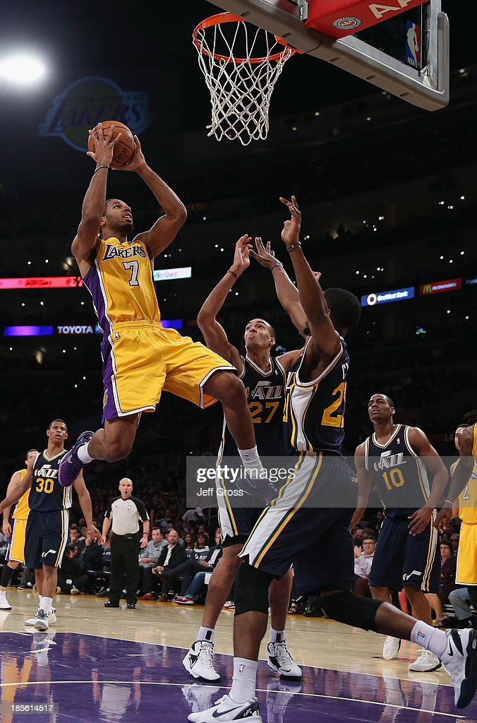 <a gi-track='captionPersonalityLinkClicked' href=/galleries/search?phrase=Xavier+Henry&family=editorial&specificpeople=5792007 ng-click='$event.stopPropagation()'>Xavier Henry</a> #7 of the Los Angeles Lakers shoots over <a gi-track='captionPersonalityLinkClicked' href=/galleries/search?phrase=Rudy+Gobert&family=editorial&specificpeople=7616046 ng-click='$event.stopPropagation()'>Rudy Gobert</a> #27 and Ian Clark #21 of the Utah Jazz in the second half at Staples Center on October 22, 2013 in Los Angeles, California. The Lakers defeated the Jazz 108-94.