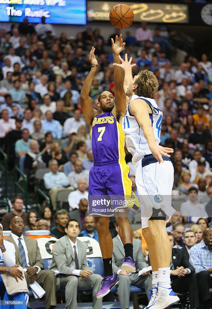Xavier Henry #7 of the Los Angeles Lakers takes a shot against Dirk Nowitzki #41 of the Dallas Mavericks at American Airlines Center on November 5, 2013 in Dallas, Texas.