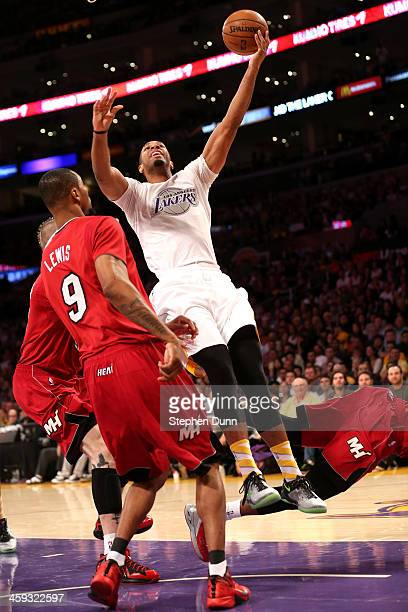 Xavier Henry of the Los Angeles shoots over Rashard Lewis of the Miami Heat Lakers at Staples Center on December 25 2013 in Los Angeles California...