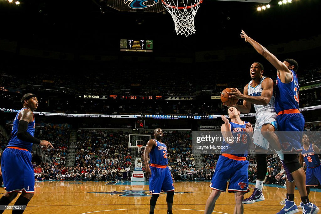 Xavier Henry #4 of the New Orleans Hornets drives to the basket against Rasheed Wallace #36 of the New York Knicks on November 20, 2012 at the New Orleans Arena in New Orleans, Louisiana.