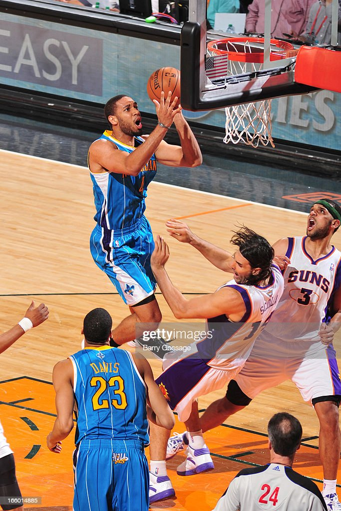 <a gi-track='captionPersonalityLinkClicked' href=/galleries/search?phrase=Xavier+Henry&family=editorial&specificpeople=5792007 ng-click='$event.stopPropagation()'>Xavier Henry</a> #4 of the New Orleans Hornets drives to the basket against <a gi-track='captionPersonalityLinkClicked' href=/galleries/search?phrase=Luis+Scola&family=editorial&specificpeople=2464749 ng-click='$event.stopPropagation()'>Luis Scola</a> #14 of the Phoenix Suns on April 7, 2013 at U.S. Airways Center in Phoenix, Arizona.