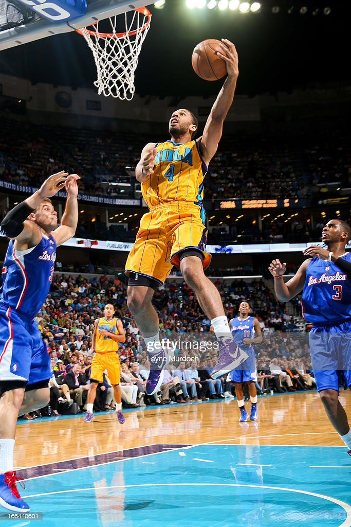 Xavier Henry #4 of the New Orleans Hornets drives to the basket against Blake Griffin #32 of the Los Angeles Clippers on April 12, 2013 at the New Orleans Arena in New Orleans, Louisiana.