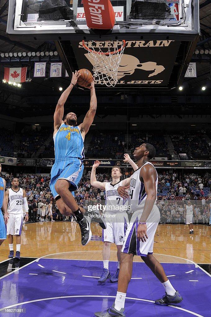 Xavier Henry #4 of the New Orleans Hornets dunks the ball against Jason Thompson #34 of the Sacramento Kings on April 10, 2013 at Sleep Train Arena in Sacramento, California.