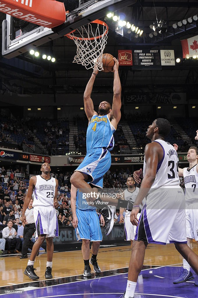 Xavier Henry #4 of the New Orleans Hornets dunks the ball in front of Jason Thompson #34 of the Sacramento Kings on April 10, 2013 at Sleep Train Arena in Sacramento, California.