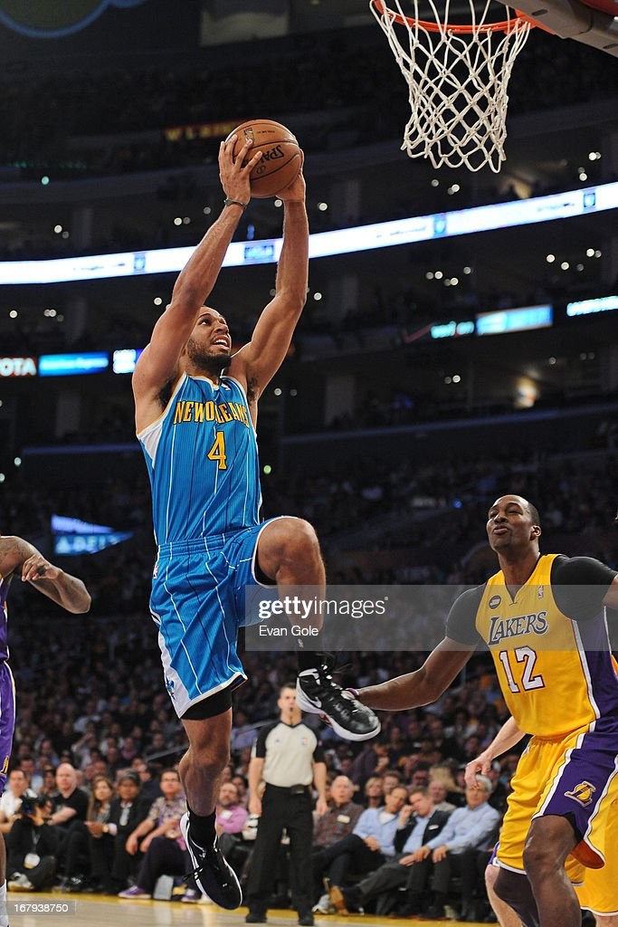 Xavier Henry #4 of the New Orleans Hornets goes up for the dunk against Dwight Howard #12 of the Los Angeles Lakers at Staples Center on April 9, 2013 in Los Angeles, California.
