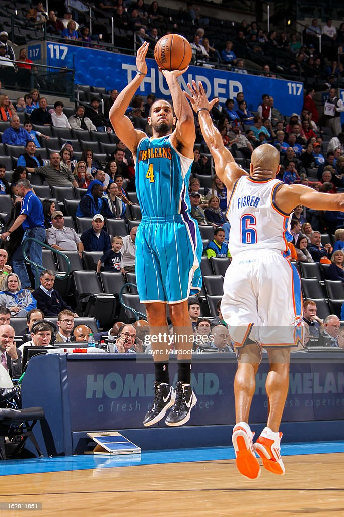 Xavier Henry #4 of the New Orleans Hornets shoots a three-pointer against Derek Fisher #6 of the Oklahoma City Thunder on February 27, 2013 at the Chesapeake Energy Arena in Oklahoma City, Oklahoma.