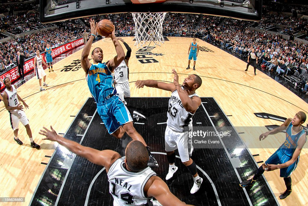 <a gi-track='captionPersonalityLinkClicked' href=/galleries/search?phrase=Xavier+Henry&family=editorial&specificpeople=5792007 ng-click='$event.stopPropagation()'>Xavier Henry</a> #4 of the New Orleans Hornets shoots in the lane against <a gi-track='captionPersonalityLinkClicked' href=/galleries/search?phrase=Boris+Diaw&family=editorial&specificpeople=201505 ng-click='$event.stopPropagation()'>Boris Diaw</a> #33 and <a gi-track='captionPersonalityLinkClicked' href=/galleries/search?phrase=Gary+Neal&family=editorial&specificpeople=5085165 ng-click='$event.stopPropagation()'>Gary Neal</a> #14 of the San Antonio Spurs on December 21, 2012 at the AT&T Center in San Antonio, Texas.