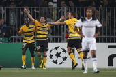 Xavier Hochstrasser of Young Boys celebrates scoring his sides third goal during the UEFA Champions League PlayOff first leg match between BSC Young...