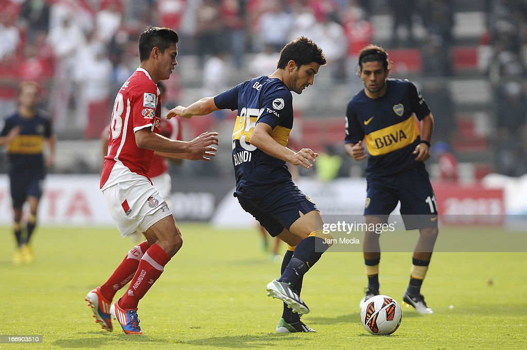 Xavier Ivan Baez (L) of Toluca struggles for the ball with Nicolas Blandi (R) of Boca Juniors during the match between Toluca from Mexico and Boca Jrs from Argentina as part of the Copa Bridgestone Libertadores 2013 at Nemesio Diez Stadium on April 17, 2013 in Toluca, Mexico.