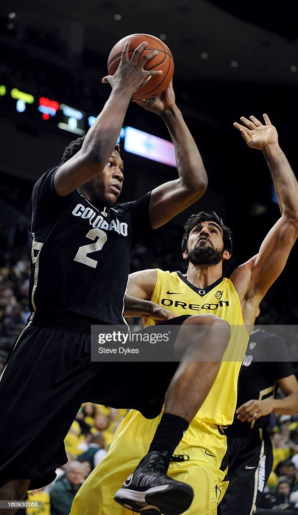 Xavier Johnson #2 of the Colorado Buffaloes drives to the basket on Arsalan Kazemi #14 of the Oregon Ducks in the half of the game at Matthew Knight Arena on February 7, 2013 in Eugene, Oregon. Colorado won the game 48-47.