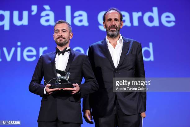 Xavier Legrand and Alexandre Gavras receive the 'Luigi De Laurentiis' Venice Award for a Debut Film Award fore 'Jusqu'à la Garde' during the Award...