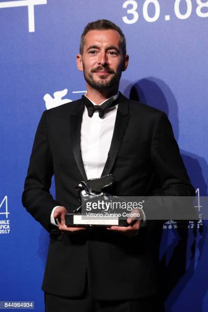 Xavier Legrand poses with the Silver Lion for Best Director Award for 'Jusqu'à la Garde' at the Award Winners photocall during the 74th Venice Film...