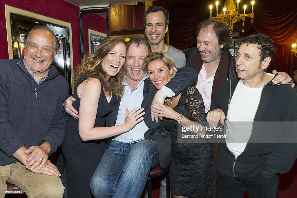 Xavier Letourneur, Jessica Borio, Daniel Russo, Jean-Francois Cros, Axelle Marine, Sylvain Meyniac and Gerard Loussine pose following the 100th performance of the play 'Hier Est Un Autre Jour' at Theatre des Bouffes Parisiens on May 11, 2013 in Paris, France.