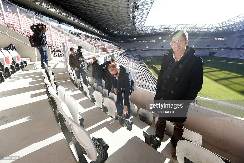 Xavier Lortat-Jacob, president of the Nice Eco-Stadium, (R) poses on the tribune's balcony after an investigation has been launched into the violence that surrounded Sunday's French Ligue 1 match between Nice and Saint-Etienne, on November 25, 2013 at the Allianz Riviera stadium in Nice, southeastern France. Eight people were hurt after fans from the two sides tore up seats inside the Allianz Riviera stadium in Nice and hurled them at each other.