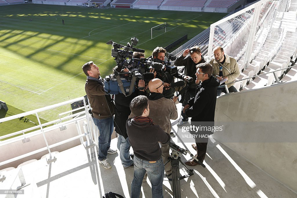 Xavier Lortat-Jacob, president of the Nice Eco-Stadium, (R) speaks to journalists on the tribune's balcony after an investigation has been launched into the violence that surrounded Sunday's French Ligue 1 match between Nice and Saint-Etienne, on November 25, 2013 at the Allianz Riviera stadium in Nice, southeastern France. Eight people were hurt after fans from the two sides tore up seats inside the Allianz Riviera stadium in Nice and hurled them at each other.