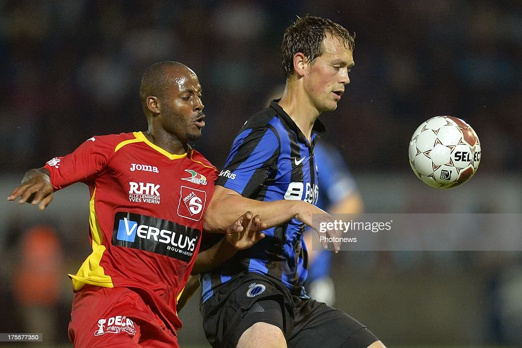 Xavier Luissint of KV Oostende battles for the ball with Tom De Sutter of Club Brugge during the Jupiler Pro League match between KV Oostende and Club Brugge KV on August 4, 2013 in Oostende, Belgium. (Photo by Peter De Voecht/Photonews