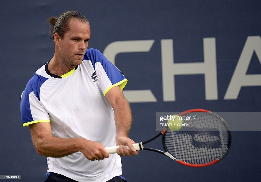 Xavier Malisse of Belgium against Andreas Seppi of Italy during their 2013 US Open singles match at the USTA Billie Jean King National Tennis Center in New York on August 28, 2013.